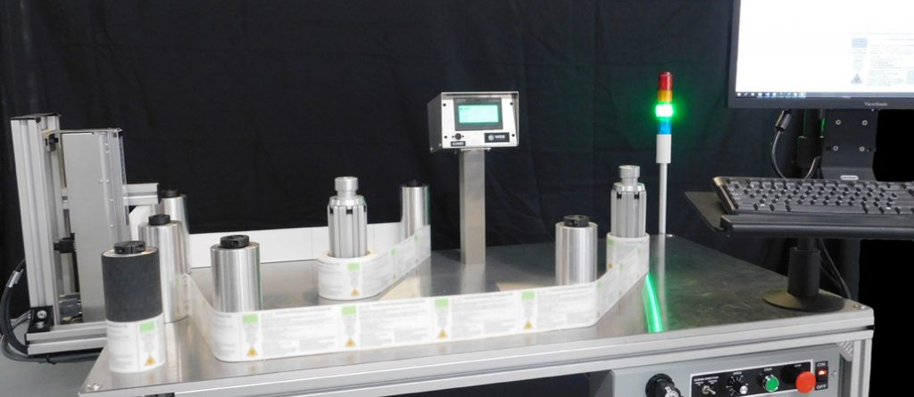 label inspection system with rewind table